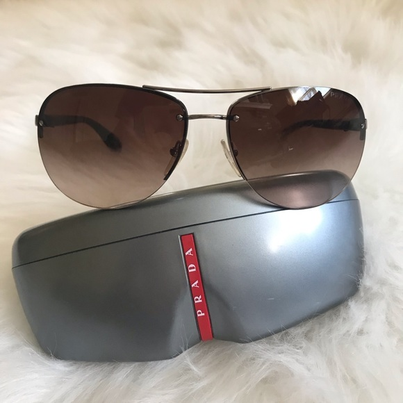 1415250f6c9ee Prada aviator sunglasses. M 5c6c64e1baebf68fe0cbc4ac